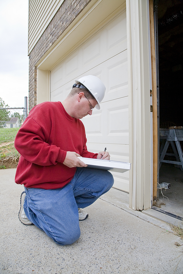Home inspector looking for possible problems to list in his building condition report