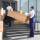 Corporate removals movers carrying shelving units for furniture
