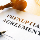 Prenuptial agreement and gavel in a court.