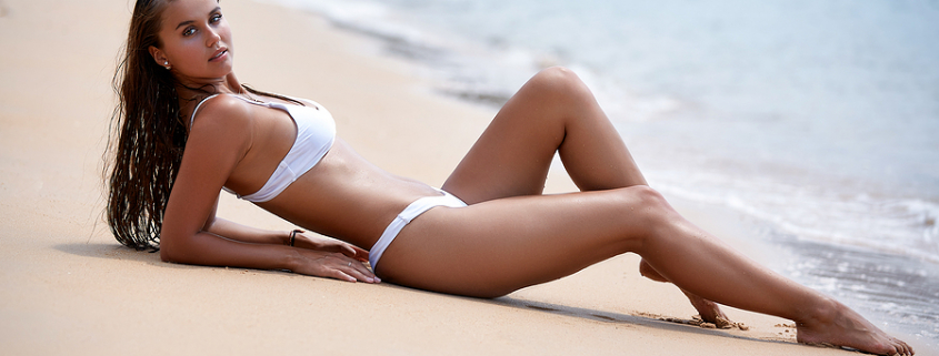 Sexy woman wearing designer swimsuits