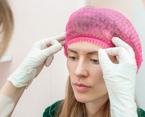 Beautician prepares client for microbladed brows